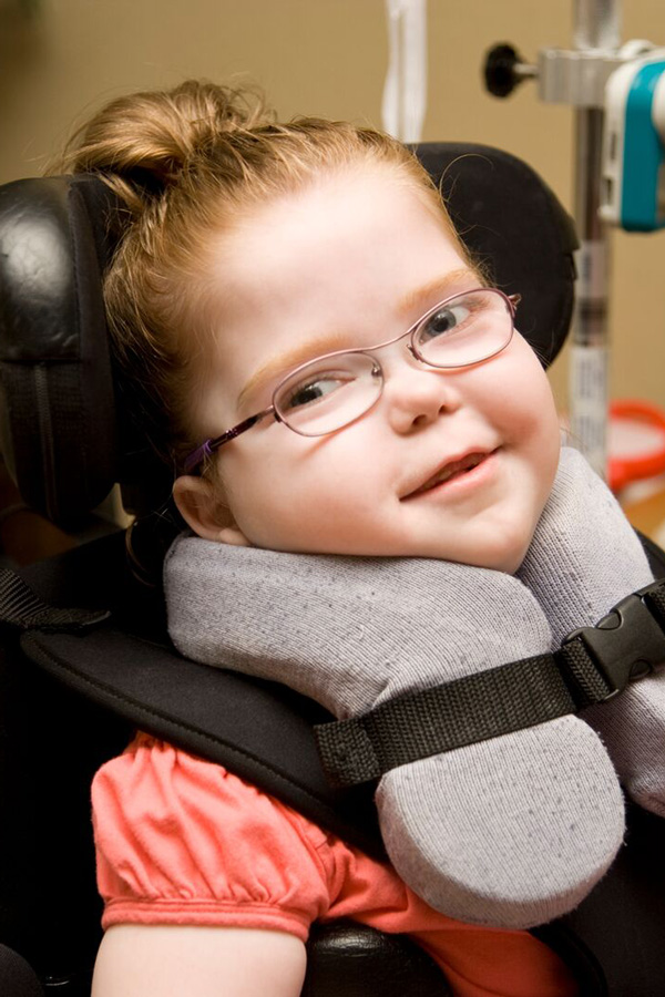 A child with a developmental disability in a wheelchair