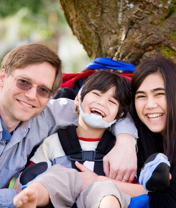 A child with a developmental disability with mom and dad